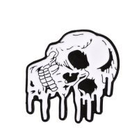 MELTING SKULL PIN